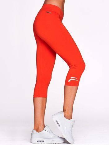 Krótkie legginsy na siłownię z kontrastowym logo ciemnopomarańczowe