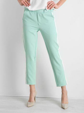 Miętowe damskie spodnie z lampasami