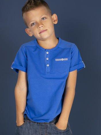 Niebieski dziecięcy t-shirt bawełniany z guzikami i kieszonką
