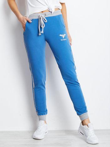 Niebieskie bawełniane spodnie dresowe z lampasami