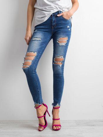 Niebieskie damskie jeansy destroyed