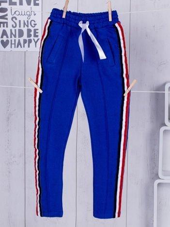 Niebieskie dziecięce spodnie dresowe ze wstążką