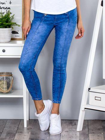Niebieskie jeansowe spodnie skinny z guzikami