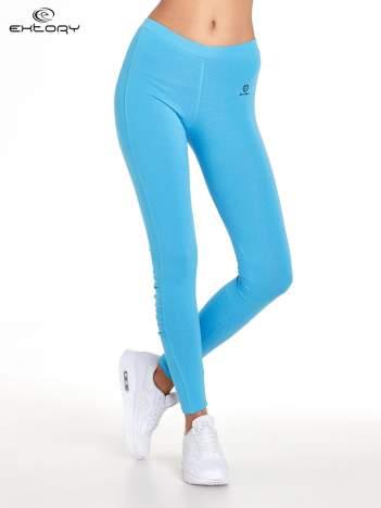 Niebieskie legginsy sportowe termalne z drapowaniem