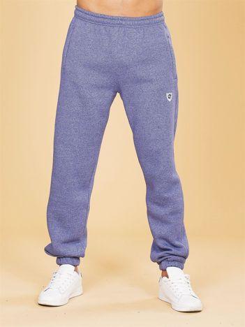 Niebieskie ocieplane męskie spodnie dresowe
