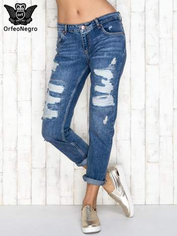 Niebieskie spodnie boyfriend jeans z dziurami