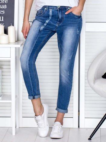 Niebieskie spodnie jeansowe damskie z ozdobnym suwakiem