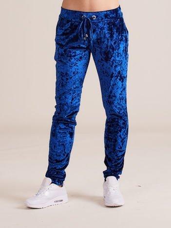 Niebieskie welurowe spodnie dresowe z troczkami