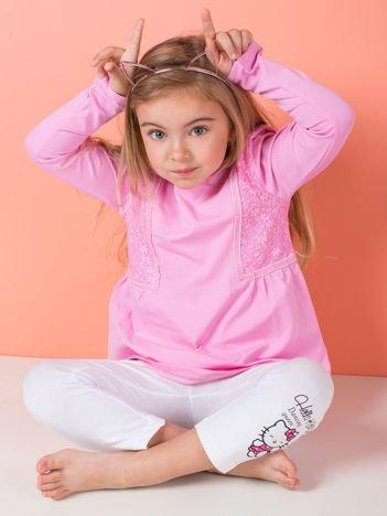 Różowa bluzka dziewczęca z koronkowymi wstawkami