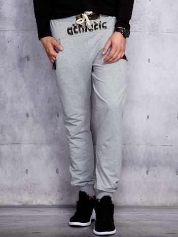 Spodnie dresowe męskie szare z troczkami i naszywkami