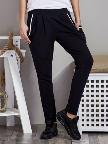 Spodnie dresowe ze ściągaczami przy kieszeniach czarne