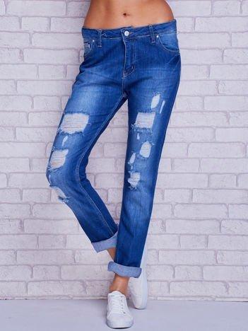Spodnie jeansowe boyfriend z dziurami niebieskie