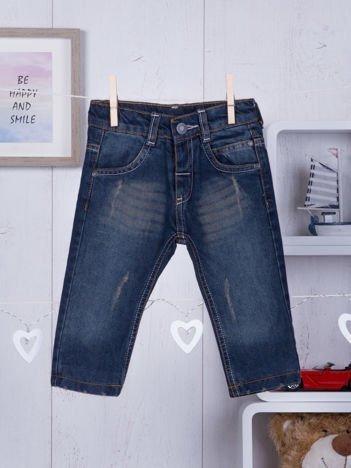 Spodnie jeansowe dla niemowlaka z lekkimi przetarciami chłopięce granatowe