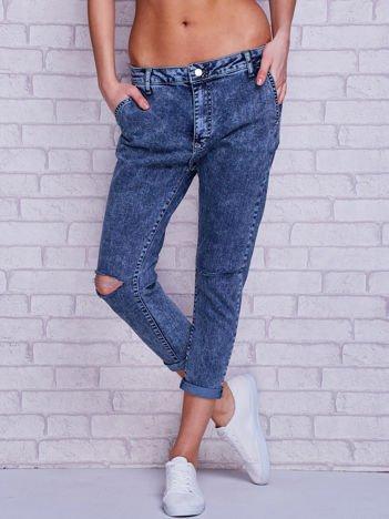 Spodnie jeansowe marmurkowe z dziurami niebieskie