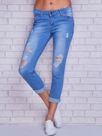 Spodnie jeansowe rurki z dziurami i przeszyciami niebieskie