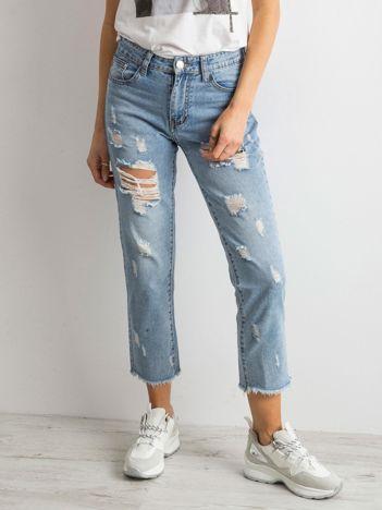 Spodnie mom jeans z dziurami niebieskie