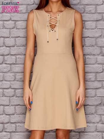Sukienka lace up beżowa