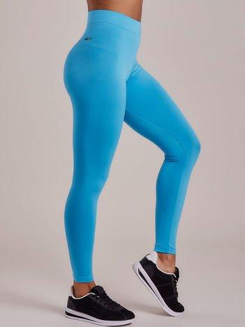 Turkusowe długie cienkie legginsy do biegania