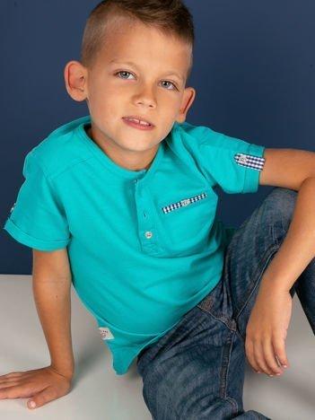 Turkusowy dziecięcy t-shirt bawełniany z guzikami i kieszonką