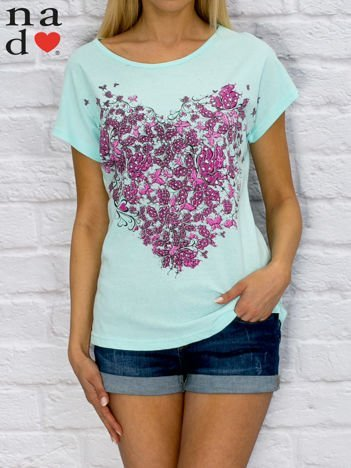Turkusowy t-shirt z roślinnym nadrukiem