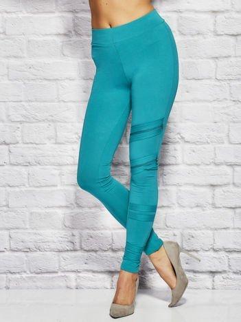 Zielone legginsy z suwakami