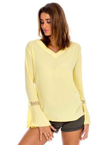 Żółta bluzka z rozszerzanymi rękawami