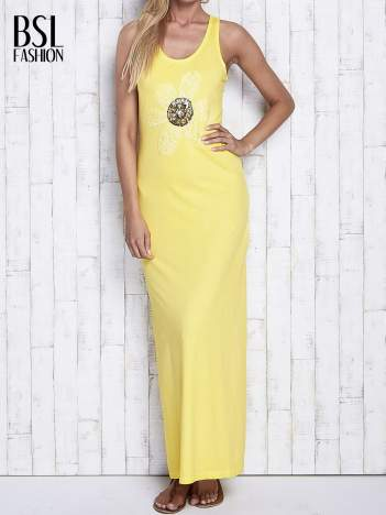 Żółta dekatyzowana sukienka maxi z cekinowym kwiatem