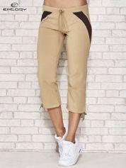 Beżowe spodnie sportowe capri ze wstawkami