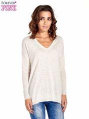 Beżowy sweter V-neck z rozporkami