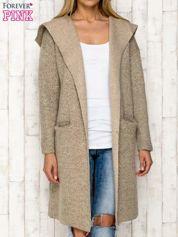 Beżowy sweter oversize z melanżowej dzianiny