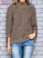 Beżowy wełniany sweter ze złotą nitką