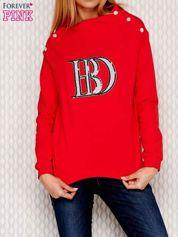 Bluza z cekinową naszywką czerwona
