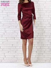 Bordowa sukienka ze srebrną kokardą