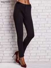 Czarne dopasowane spodnie z siateczkowym pasem