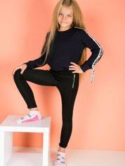 Czarne dziewczęce legginsy z pikowaniem i suwakami