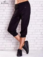 Czarne spodnie capri z lampasami i troczkami PLUS SIZE