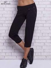 Butik Czarne spodnie capri z wszytymi kieszeniami