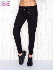 Czarne spodnie dresowe z wiązaniem