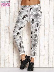 Ecru spodnie dresowe z nadrukiem skóry węża i brokatową aplikacją