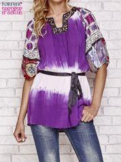 Fioletowa koszula wiązana w pasie z ozdobnymi kamieniami