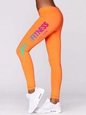 Fluo pomarańczowe długie legginsy fitness z nadrukiem na nogawce