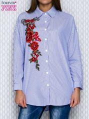 Koszula w niebieskie paski z kwiatową naszywką