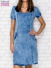 Niebieska sukienka z wycięciami na plecach