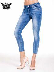 Niebieskie spodnie skinny jeans z cieniowaniem i ciętą nogawką
