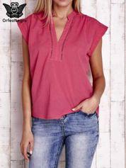 Różowa bluzka koszulowa z ażurowaniem wzdłuż dekoltu