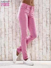 Różowe spodnie skinny jeans biodrówki