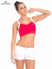 Różowy top stanik sportowy z białym ramiączkami i wycięciem z tyłu
