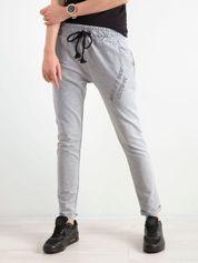 Szare damskie spodnie dresowe z dżetami