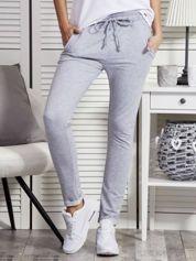 Szare spodnie dresowe damskie z kieszeniami