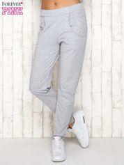 Szare spodnie dresowe z napami